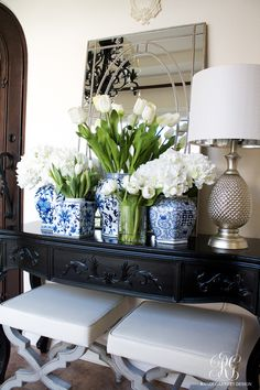 Blue and white Spring entry using fresh and faux flowers by Randi Garrett Design