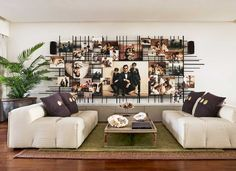 Hrithik Roshan's home: An island of calm and good humour - check out the family photos. They are mounted on a movable grid and can be changed.  How MUCH do I LOVE this idea.  It is sheer perfection