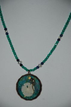 Handpainted background, real sand dollar and seahorse.  Necklace is crystal, fresh water pearl and lapis.