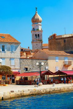 Krk. It is not only sun & sea, but also rich ancient history. Port and 16th century Gothic styled bell tower topped with a 1767 Baroque dome of the Cathedral of Krk, Krk Island, Croatia.