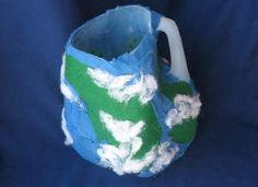 Earth Jug Planter: This clever planter was once a milk jug! Recycle this plastic jug into a globe-themed planter for flowers or herbs, perfect for Earth Day. [click for how to]
