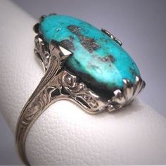 A superb combination, vibrant turquoise and antique white gold setting, Art Deco era circa 1920.  Buy it today at Aawsomblei Antique Jewelry online jewelry store.  #aawsombleijewelry #artdeco #vintage #victorian #steampunk #california #hollywood #jewelrygram #losangeles #love #gorgeous #instagood #instabeauty #giftforher #jewelrystore #photooftheday #macrophotography #jewelrybox #finejewelry #estatejewelry #antiquering #antiquejewelry #buyitnow #filigreering #gemstone #stylist #eventplanner…