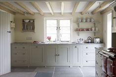 Love the floor, the wall color, the cabinet style, the plank door and the beams.