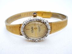 """Dufonte Lucien Piccard Diamond Wrist Watch Gold Mesh Band New Battery Works  This is a Dufonte Lucien Piccard wristwatch with gold tone mesh band.  It has an oval watch case that measures slightly over .75"""" by slightly over .63"""", with 10 small diamonds, has a gold face and numbers.  The band is 6.5"""" long and has slight wear on the inside of the band.  This watch is in good working condition and has a new battery."""