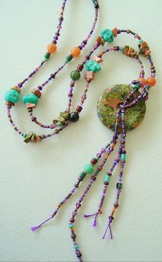 Seed bead Unakite necklace. Tassels for fun- bright disc, circular, all flows into itself. Color to catch the eye and express creativity.