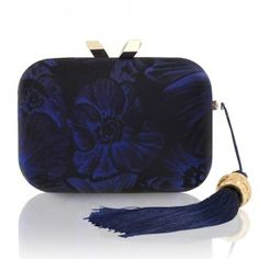 The Morley Monte Carlo Brocade with Tassel in Dark Blue is the perfect companion from day to night. The stylish clutch features a hidden magnetic closure, signature brocade lining, and a drop-in shoulder chain. The clutch fits up to two phones (up to iPhone 6) and essentials, including your favourite makeup . The Morley Monte Carlo in Dark Blue clutchbag comes with a drop in shoulder chain and fits all smartphones plus evening essentials