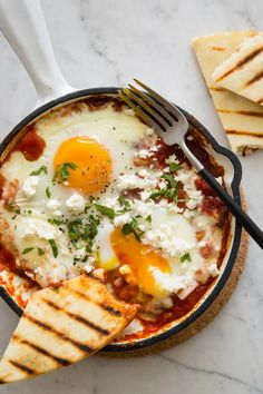 A recipe for Individual Shakshuka with Hominy and Feta. Quick and easy recipe and delicious. I used grits because that's what I had.