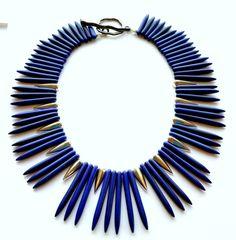 Beautiful Lapis Blue Howlite sticks combined with silver plated spikes to create a sleek statement. This neck piece lays very nice around the neck with a 11/2 silver chain extension. Looks great with