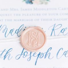 Small details can make a grand statement! This pearlized pale pink wax seal with Madison + Seth's monogram mixes well with classic blue calligraphy. Imagine opening this gorgeous invitation wrapped in twine - it's like receiving a special gift in the mail! . . . 📷 | @katelynjames . . . #weddingmonogram #waxseal #personalizedwaxseal #weddingsuite #weddinginvitation #monogramlove #vintagemonogram #weddingdetails #shulerstudio #theknot