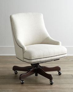 "White upholstered, with nailhead trim (""Littleton"" Swivel Office Chair, Horchow)"