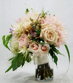 An amazing take on a classic bridal bouquet in pinks and whites. dahlias, amnesia roses, astilbe, explosion grass, spray roses Flowers by April's Garden in Durango,CO http://www.durangoflorist.com/