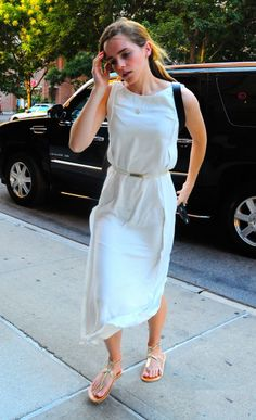 Emma Watson street style - white maxi dress, skinny belt, sandals