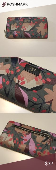 Fossil wallet Adorable floral print on this fossil wallet.  Really cute.  A little wear as shown in photos.  It almost looks like it's made that way.  Price reflects.  Bundle for best deals. Fossil Bags Wallets