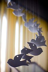 Wind chime - try making pierced tin butterflies and then hanging like this
