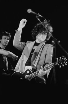 Singer Marc Bolan and bassist Herbie Flowers of TRex perform on stage at the Apollo in Manchester on March 11 1977 Marc Bolan, Cummins, Poetry Photos, Stock Pictures, Stock Photos, Beat Generation, Glamour, Bond Street, The Godfather