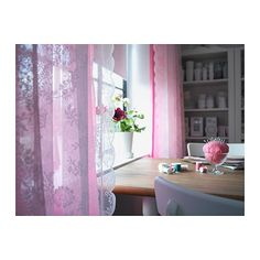 ALVINE SPETS Pair of curtains IKEA The curtains let the daylight through but provide privacy so they are perfect to use in a layered window solution.