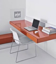 Home office design idea - Attaching the desktop to the wall clears floor space and creates clean, modern lines.