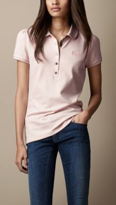 CHECK PLACKET POLO SHIRT $150.00 A feminine polo shirt in stretch piqué cotton. Slim fitting, the shirt features gathered shoulders, a check-lined placket and a Peter Pan collar. 98% cotton, 2% elastane Machine wash Imported