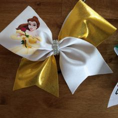 Princess Inspired Bows hand made with mystique Spandex and Rhinestone center tie! Select your favorite princess! Headband Hairstyles, Diy Hairstyles, Cute Cheer Bows, Princess Hair Bows, Kids Hair Bows, Fabric Bows, Bow Hair Clips, Cheer Stuff, Handmade