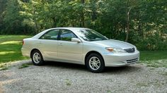 2002 Toyota Camry LE 4 Cylinder 285,000 miles still running strong!