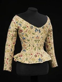 Stuart Jacket   This jacket dates from between 1600 - 1625 and was made in England. It is made of linen and is embroidered with silk and metal thread. The pattern consists of mostly flowers such as honeysuckle, irises, red and white roses and lilies, but also contains butterflies, caterpillars and birds. This kind of jacket would likely be worn by a woman of the court, although it is of a more informal style.