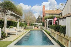 The 28' pool, surrounded by zoysia grass and flagstone deck with arbor, is enclosed by a Williamsburg inspired picket fence.