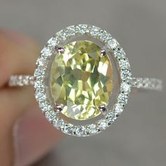 Yellow Sapphire Ring!!!!!!!!!!!!! This might be my favorite setting by far, i would make it an opal though ;)