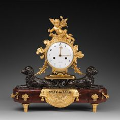 A Louis XVI ormolu, patinated bronze and rouge griotte marble mantel clock
