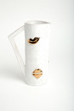 golden kiss carafe - LUX / EROS Kiss Collection-  The Kiss Collection pays homage to the motif on vases and tumblers adorned with a variety of lips, some are sealed others open to a butterfly smack. Each Kiss carafe is handmade and original and comes with a kiss! - White glaze on speackled clay with gold lips detail