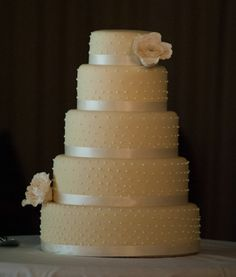 Ivory wedding cake.   This one would be pretty with the monogram letter on top of the I do