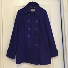 Royal Blue Pea Coat Royal blue pea coat, black and grey floral lining, faux pockets, buttons up front,button accent on sleeve cuffs, size L, worn once. Delias Jackets & Coats Pea Coats