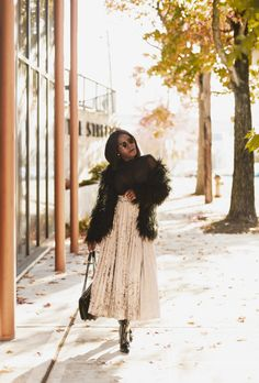 Love the way fashion blogger Frilancy styled this faux fur jacket and velvet maxi skirt. She is definitely giving us fall and holiday vibes. Fall Fashion, Maxi Skirt, Velvet Skirt, Fluffy Fur Jacket, Faux fur jacket, Chanel Bag, Black Booties, JustFab, Ray Bans, Bodysuit, Holiday Fashion, Holiday Looks, Fur Coat, Church Fashion, Church Style.