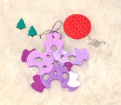 Christmas Gift Set I - Includes: a stylish snowflake decor item, handcrafted out of polymer clay, using the filigree technique. The snowflake futures white polymer and a cool sample of purple shades. A pair of emerald green polymer clay earrings, shaped as two Christmas Trees. And a red, knitted polymer brooch with Santa's slay as a silver metal charm!  #HolidaySeason #ChristmasIsComing