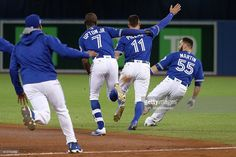 and Kevin Pillar of the Toronto Blue Jays chase after teammate Russell Martin after the Toronto Blue Jays defeated the Texas Rangers in ten innings during game three of the. Kevin Pillar, Russell Martin, Baseball Memes, Rogers Centre, American League, Toronto Blue Jays, Go Blue, Toronto Canada, Texas Rangers