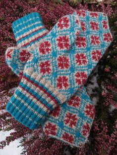 Finely Hand Knitted Estonian Mittens in Red and Blue on Grey. $89.00, via Etsy.