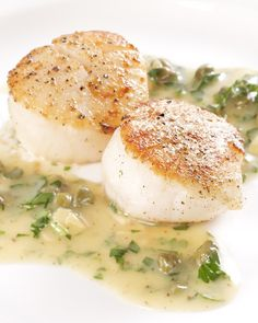Seared scallops make an elegant pairing with a flavorful reduction sauce made with fish stock, sherry vinegar, and brown butter. Capers, sliced almonds, and parsley are stirred in at the last minute. This recipe serves four as as an appetizer or two as a main course.