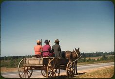 *Going to town on Saturday afternoon. Greene County, Georgia, May 1941. Reproduction from color slide. Photo by Jack Delano. Prints and Photographs Division, Library of Congress