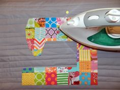 I LOVE this one!  Maybe I'll get a little creative with my cover :)  Ellison Lane Quilts: Sewing Machine Cover Tutorial