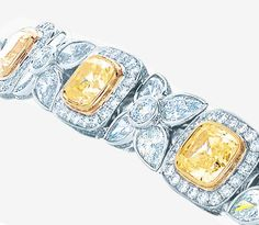 This tiara incorporates a detachable bracelet accented  with nine fancy intense Tiffany Yellow Diamonds.