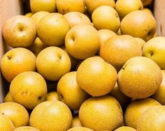 Asian Pears at the Market. Fine Art Food Photography Print for Home Decor Wall Art. Freshly picked asian pears displayed in wooden crate at the farmers market. ~~ SELECT DESIRED SIZE USING THE OPTIONS BUTTON ABOVE ADD TO CART. Available in: 5x7, 8x10, 11x14, 12x18, 16x20, 20x30, 24x36 prints.