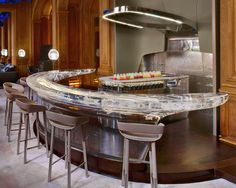 Bar Alain Ducasse au Plaza Athénée - Resin counter with Glow rings lighting a Stainless steel island prep - jouin manku