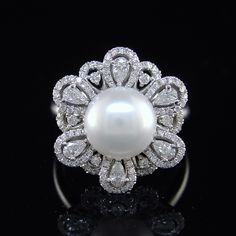 Pearl Cocktail Ring A contemporary pre-owned ring of impressive size. Set with a central 10mm freshwater button pearl within a border of pear shaped and round diamonds. Total carat weight 0.93. All mounted in 18k white gold. A fantastic saving against the current new replacement value.