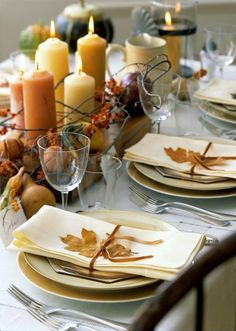 Thanksgiving Dinner Decor -love the leaves tied on top of the napkins- I would add more flowers and berries to the mix along the table!