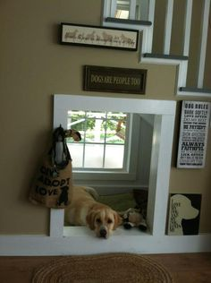 "Cute idea for a pup! A ""dog house"" under the stairs. They have their own space and window."
