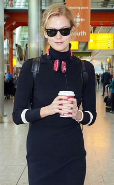 Karlie Kloss accessorized a navy turtle neck sweater dress with classic wayfarer sunnies for a casually cool look!