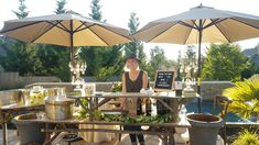 This bar had a bit of a cabana feel going. It was 105 this day. Taupe umbrellas dotted the reception. Twig tables with risers, various containers for iced beverages, and vintage crystal chandelier lamps created a nice bar. Bar service by Roam the Bar. Event styling, rentals, and floral by On The Side Events & Service.