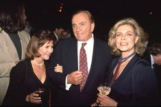 Carrie Fisher, Gore Vidal, and Lauren Bacall shmooze at a party in 2004.