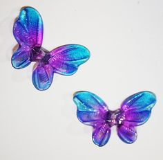 """This is a set of our very popular butterfly beads in the really bright colors  Each piece is hand blown out of pyrex (boro) glass, kiln annealed in our Bend, OR studio and hand colored long lasting glass stains.  Size: Approx 1"""" each."""