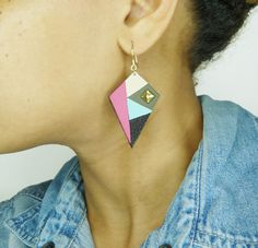 African inspiration for these leather earrings handmande in Paris. Mama Africa earrings by www.adornessjewelry.etsy.com