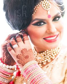 Indian wedding bride getting ready in pink. Gorgeous bridal mehndi and bridal makeup. Wedding photography by JSK Photography